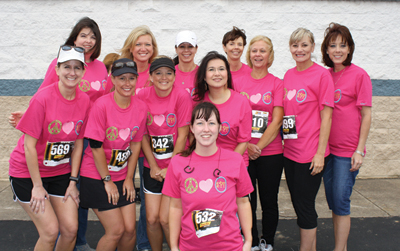 """Cher Masters (front) and her friends/ co-workers formed a team to participate in the Toad Suck Daze Run in celebration of her fifth """"cancer free"""" anniversary following a skin cancer diagnosis. The team included Jen Moix (first row, from left), Linda Koger, Mary Goodwin, Michelle Hoyt; Jennifer Campbell (back), Nikki Burk, Paula Prock, Jami Springer, Nancy Thessing, Shari Hoover and Mary Tate. Not pictured: Sherri Pillow and Tracy Coney."""