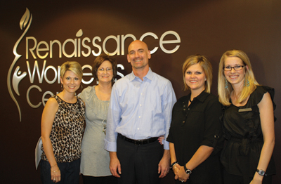 Dr. Michael Wood (center) with employees Tracy Clifft, Lameta McMillen, Lori Davis, and I'Lisa Williams.