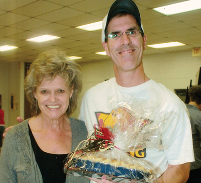 Mike Angel stands with high school math teacher Mary Joe Seiter, who baked a Dutch apple pie. Angel has had the high bid on Ms. Seiter's pie for a number of years. (Ray Nielsen photos)