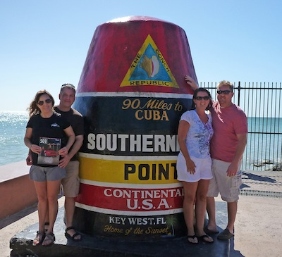 Jill and Cory Imboden (left) and Christy and Paul Hudson at the Southern Most Point in the continental U.S. at Key West following a scuba dive on the USS Vandenburg artificial reef. The couples were in Florida for a prayer breakfast speaking engagement in Orlando.