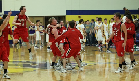 The Sacred Heart Rebels celebrate a berth to the state championship game. (Carolyn Leinhart photo.)
