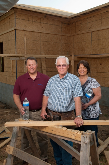 """Vilonia Mayor James Firestone (from left), Fred Fowlkes and Sandy Towles are working alongside others in """"rebuilding"""" Vilonia after last year's tornado. Towles was recognized Saturday night by the Vilonia Area Chamber of Commerce for her efforts and was named the 2012 """"Citizen of the Year."""" (Mike Kemp photo)"""