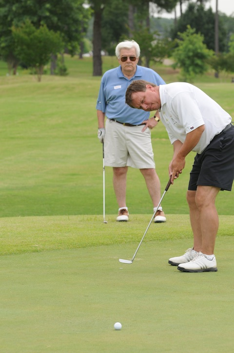 Conway Mayor Tab Townsell lines up a putt.