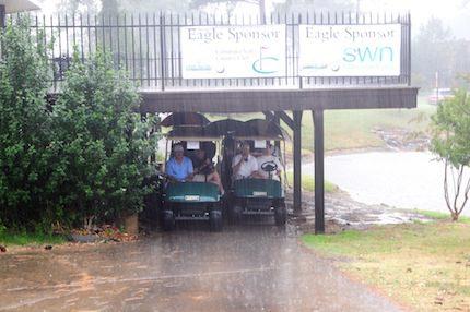 Golfers encountered a short rain delay.