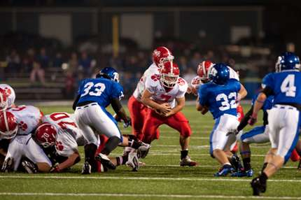 Ian Thompson fights for extra yardage against Bryant. (Todd Owens photo)