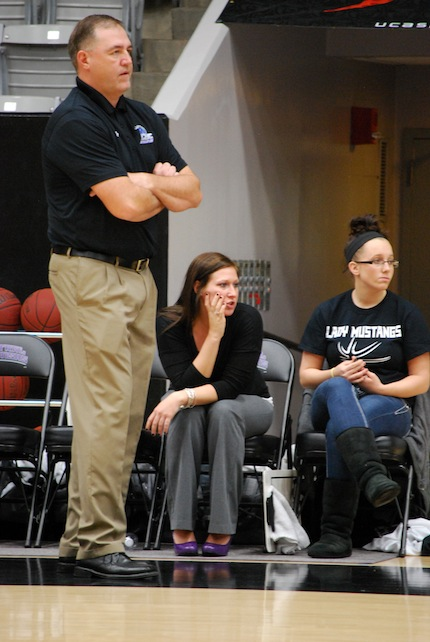 CBC coach Lyle Middleton (standing) at recent game. (Lee Hogan photo)