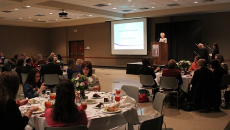 Amy Reed, president of the Conway Regional Women's Council, welcomes those attending last year's State of Health luncheon. This year, Jay Bradford, state insurance commissioner, will be the featured speaker.