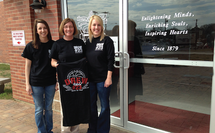 Abby, Patti and Michelle with the T-shirt created in memory of Drew.
