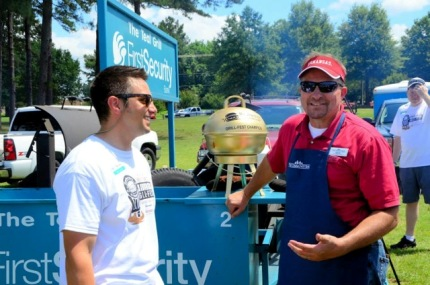 Matt LaForce with First Security Bank and Keith Riley with First Community Bank grill burgers at the Ultimate Grill Fest 2014.