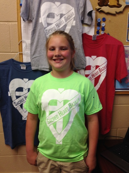 Sacred Heart sixth-grader Halen Hoelzeman designed this year's Bazaar T-shirt. Shirts are available for sale and order forms can be found on the bazaar page of the school website at sacredheartmorrilton.org.