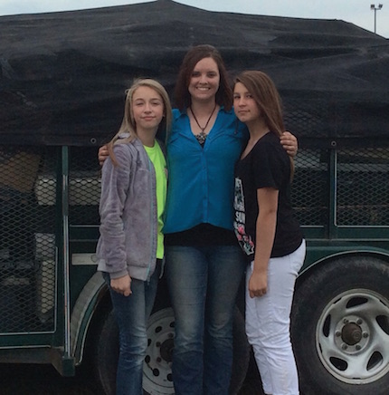 Jennifer Rodman from Conway Recycling with Emily Jordan and Brianna Branch in front of the trailer filled with electronic waste collected at the GMS Earth Day.