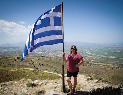 Megan Ledbetter poses with the Greek flag that proudly stands on the ruins of Acrocorinth.