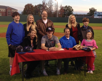 Those attending the signing ceremony for Collin Cahill (seated, center) included his parents (seated), Mary Jane (Cahill) Pettit and Doug Cahill; Carson Cahill (back, from left), Jill Pettit, Joel Pettit, Amy Cahill, James Buckner and Sophie Cahill.