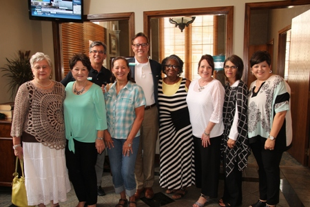Friends who worked with Denice Perry (second from left) at First National Bank: Martha Wilcox (from left), Denice, George Baker, Debbie Ferguson, Johnny Adams, Verna Hervey, Sandra Hayes, Kim Reeves and Lisa Hegeman. Denice also worked with several at First Security Bank.