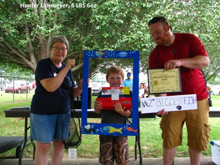 Hunter Lipsmeyer, pictured with Lorlie March  (left) and  Will Lipsmeyer,  won second place with the second biggest fish.