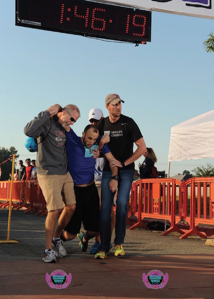 Darren Mathews of Searcy (left) and Ben Gipson help Joey Smith at the finish line of the Soaring Wings Half Marathon. Darren did not know Joey but found him on Facebook and let him know he was praying for his recovery. (Photo courtesy of Run Bike Swim Photos/ runbikeswimphotos.com)