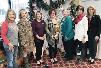 Participating in the Dazzler awards presentation: Dot Welch (associate director of the Conway Regional Health Foundation and Conway Regional Women's Council) Dazzle Daze co-chairman Amy Reed, Shannon Howland (Arvest Bank), Dazzler winner Stefanie Vann (First Security Bank), Linda Moore (Bank of the Ozarks), Dazzle Daze co-chairman Pam Sims and Lori Ross (chief development officer and corporate director of marketing/ foundation for Conway Regional Health System).