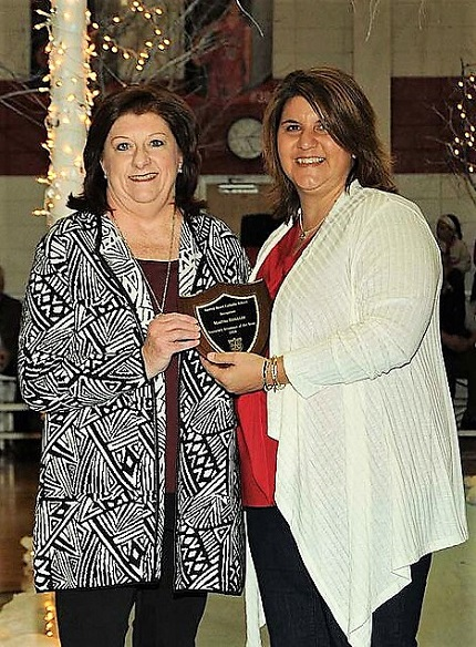 Booster Club president Djuana Beck recognized Martha Briggler as this year's Honorary Alumnus of the Year.