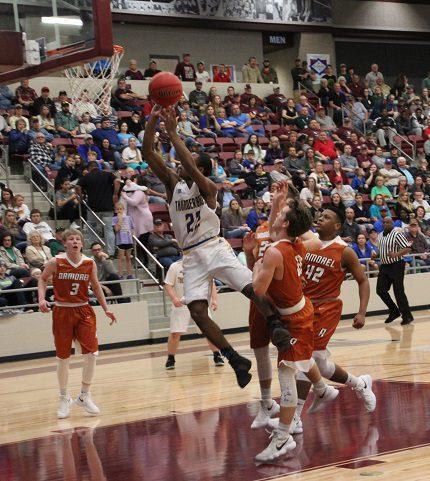 Guy-Perkins High School's Tre Minton makes a shot over the Amorel defense. (Sonja Keith photo)